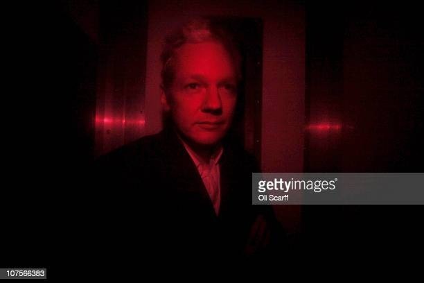 Wikileaks founder Julian Assange arrives at Westminster Magistrates Court inside a prison van with red windows on December 14 2010 in London England...