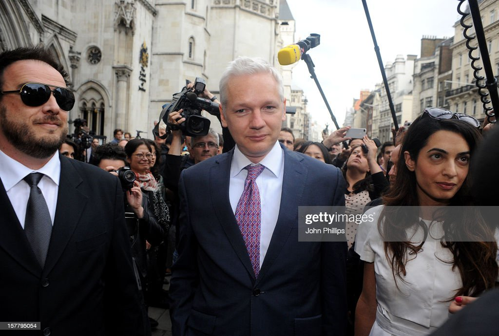 Wikileaks Founder Julian Assange, C, Leaves Britain's Royal Courts Of Justice with lawyer Amal Alamuddin After His Extradition Appeal Was Heard In Central London, Wednesday, July 13, 2011. Assange Is Fighting Extradition To Sweden On The Grounds That The Allegations Of Sexual Misconduct Laid Against Him There Don'T Amount To A Crime. Assange'S Repeated Disclosures Of Classified U.S. Documents Have Infuriated The Pentagon And Energized Critics Of American Foreign Policy, But Allegations That The 40-Year-Old Australian Molested Two Women During A Trip To Scandinavia Last Year Have Tarnished His Reputation And Cast A Shadow Over His Future.