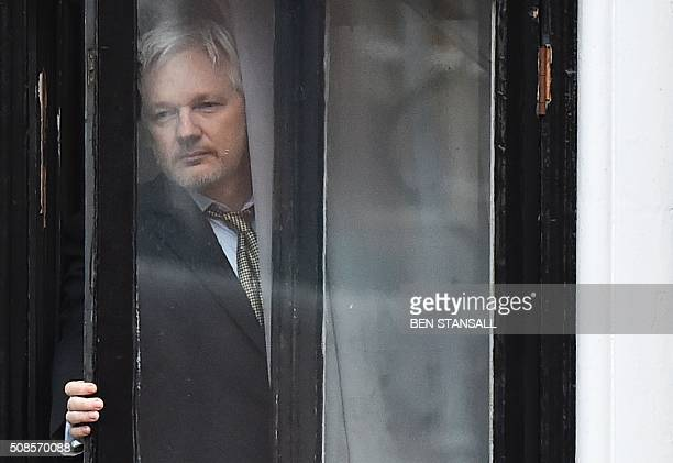 TOPSHOT WikiLeaks founder Julian Assange comes out on the balcony of the Ecuadorian embassy to address the media in central London on February 5 2016...