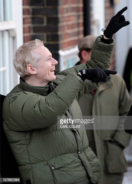 WikiLeaks founder Julian Assange gestures after a visit to Beccles police station in Suffolk eastern England on December 17 as stiplulated in his...