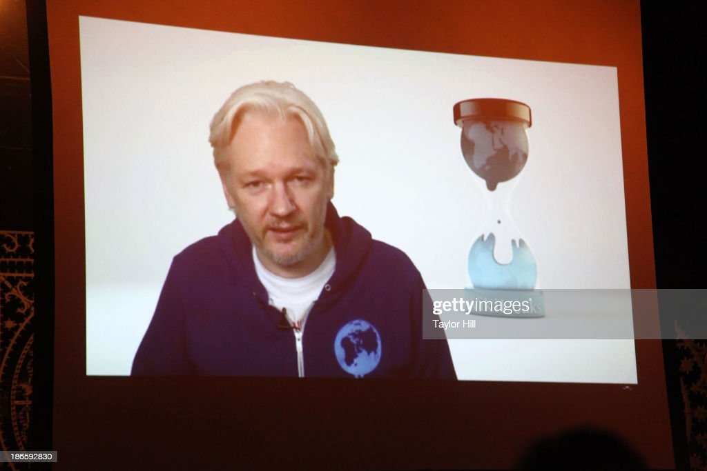 Wikileaks founder Julian Assange introduces M.I.A. via videolink from the Ecuadorian embassy in London at Terminal 5 on November 1, 2013 in New York City.