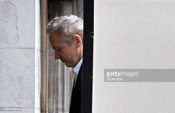 Wikileaks founder Julian Assange is led into London's High Court on December 16, 2010. WikiLeaks founder Julian Assange finds out today if a British...
