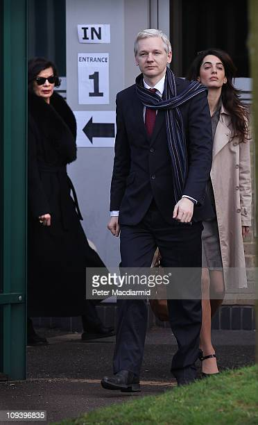Wikileaks founder Julian Assange leaves Belmarsh Magistrates Court with a member of his legal team and supporter Bianca Jagger on February 24, 2011...