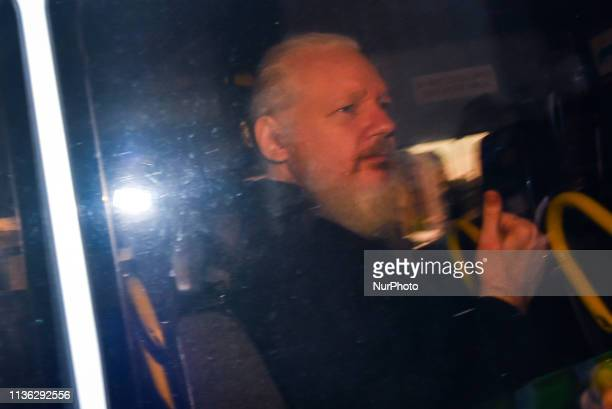 Wikileaks founder Julian Assange makes his way into the Westminster Magistrates Court after being arrested this morning by Metropolitan Police, on...