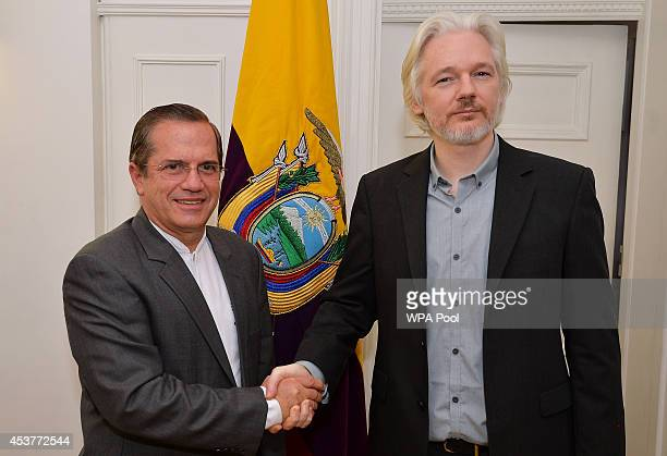WikiLeaks founder Julian Assange shake hands with Ecuadorian Foreign Minister Ricardo Patino after a press conference where he confirmed he will be...