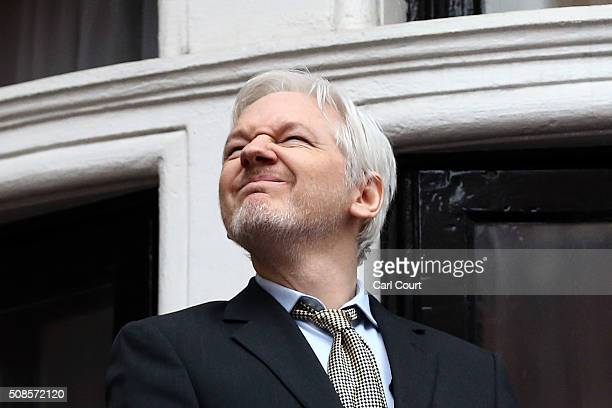 Wikileaks founder Julian Assange squints in the sunlight as he prepares to speak from the balcony of the Ecuadorian embassy where he continues to...