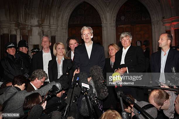 WikiLeaks founder Julian Assange stands with his legal team and speaks to reporters as he leaves The High Court on December 16 2010 in London England...