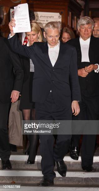 WikiLeaks founder Julian Assange waves legal papers as he leaves The High Court on December 16 2010 in London England Julian Assange has been...