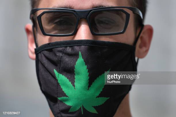 Wiktor wears a protective mask while in a street in Krakow. From today until further notice, the Ministry of Health introduced a new rule that...