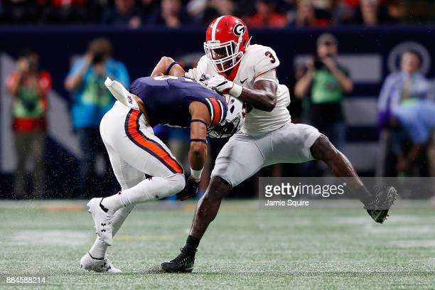 Wil Appleton of the Auburn Tigers is tackled by Roquan Smith of the Georgia Bulldogs during the second half in the SEC Championship at MercedesBenz...