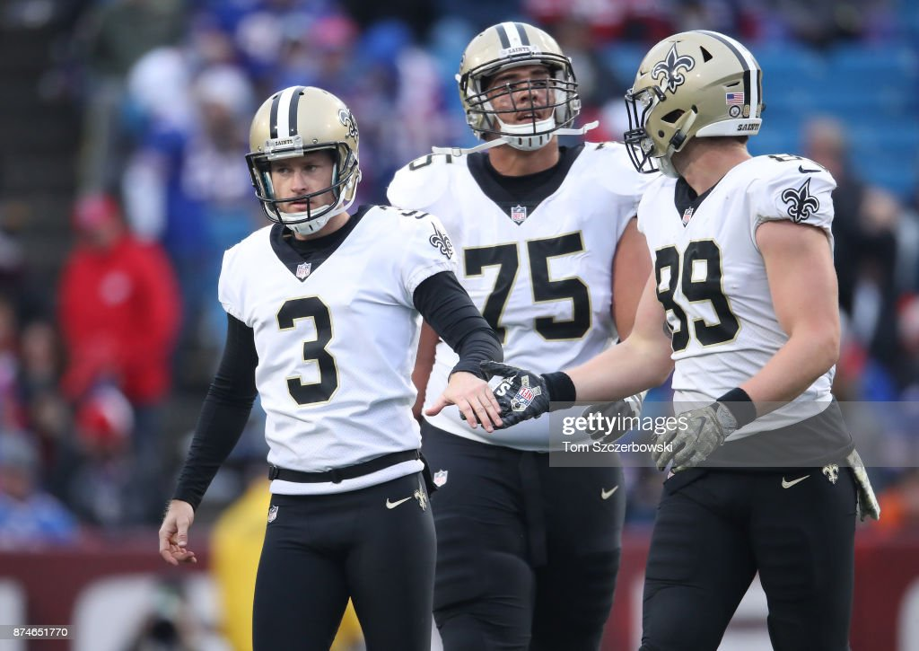 Wil Lutz of the New Orleans Saints is congratulated by Josh Hill ... 85b582eca