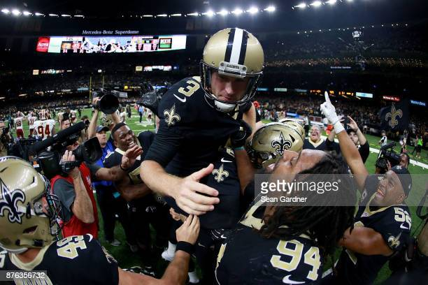 Wil Lutz of the New Orleans Saints is hoisted into the air after makeing a field goal in overtime to defeat the Washington Redskins 3431 at the...