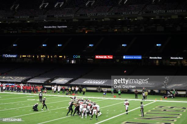 Wil Lutz of the New Orleans Saints kicks an extra point in an empty stadium against the Tampa Bay Buccaneers during the fourth quarter at the...