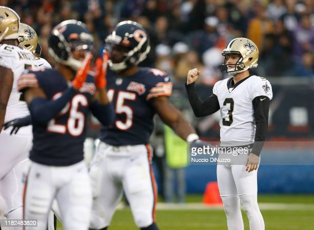 Wil Lutz of the New Orleans Saints pumps his fist before realizing that he had missed a field goal during the second half against the Chicago Bears...