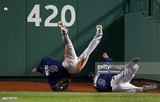 Wil Myers and Desmond Jennings of the Tampa Bay Rays collide trying to get to the game winning RBI triple off the bat of AJ Pierzynski of the Boston...