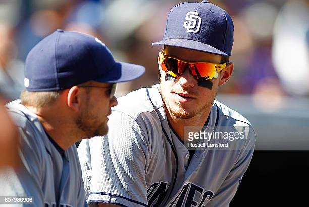 Wil Myers chats with Andy Green of the San Diego Padres prior to a regular season MLB game between the Colorado Rockies and the visiting San Diego...