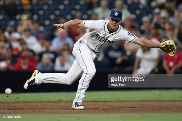 Wil Myers of the San Diego Padres attempts to make a catch at third base during the game against the Los Angeles Angels of Anaheim at PETCO Park on...
