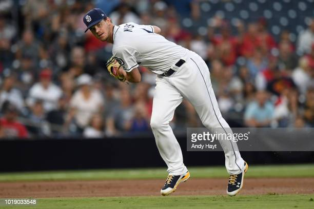 Wil Myers of the San Diego Padres catches a ball at third base and throws to first base during the game against the Los Angeles Angels of Anaheim at...