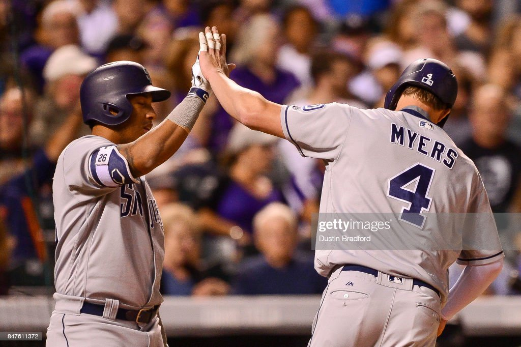 Wil Myers #4 of the San Diego Padres celebrates with Yangervis Solarte #26 after hitting a sixth inning solo homerun off of Tyler Chatwood #32 of the Colorado Rockies during a game at Coors Field on September 15, 2017 in Denver, Colorado.