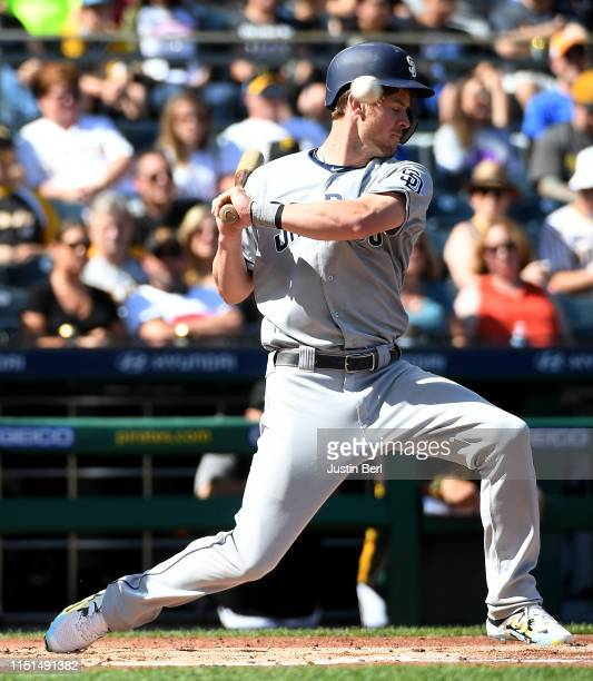 Wil Myers of the San Diego Padres ducks out of the way of a pitch throw by Chris Archer of the Pittsburgh Pirates in the second inning during the...