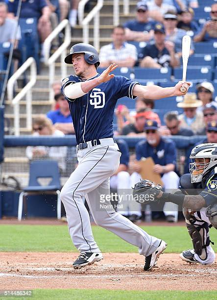 Wil Myers of the San Diego Padres follows through on a swing against the Milwaukee Brewers at Maryvale Baseball Park on March 7 2016 in Phoenix...
