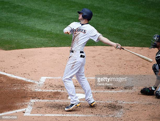 Wil Myers of the San Diego Padres hits a solo home run during the fourth inning of a baseball game against the Atlanta Braves at PETCO Park on June 8...
