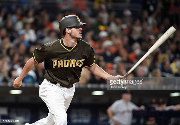 Wil Myers of the San Diego Padres hits a solo home run during the fourth inning of a baseball game against the San Francisco Giants at PETCO Park on...