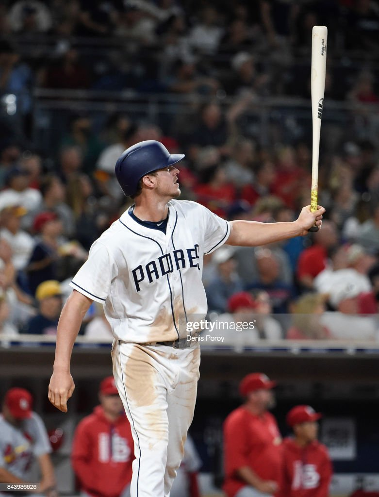 Wil Myers #4 of the San Diego Padres hits a two-run home run during the seventh inning of a baseball game against the St. Louis Cardinals at PETCO Park on September 7, 2017 in San Diego, California.