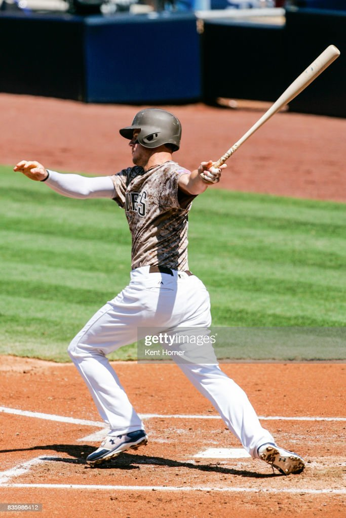 Wil Myers #4 of the San Diego Padres hits the ball during the first inning against the Washington Nationals at PETCO Park on August 20, 2017 in San Diego, California.