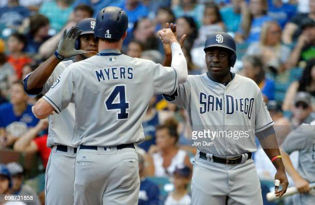 Wil Myers of the San Diego Padres is congratulated by Jose Pirela and Franchy Cordero after hitting a three run home run against the Milwaukee...