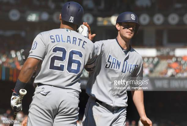 Wil Myers of the San Diego Padres is congratulated by Yangervis Solarte after Myers hit a solo home run against San Francisco Giants in the top of...