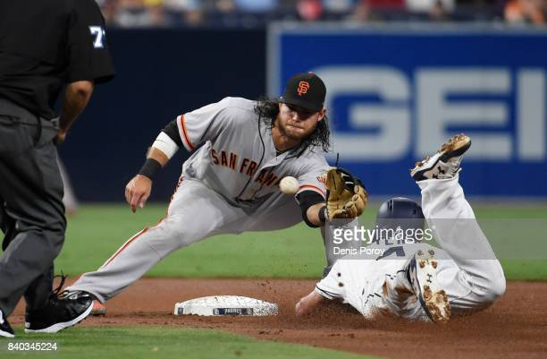 Wil Myers of the San Diego Padres is tagged out by Brandon Crawford of the San Francisco Giants as he tries to steal second base during the second...