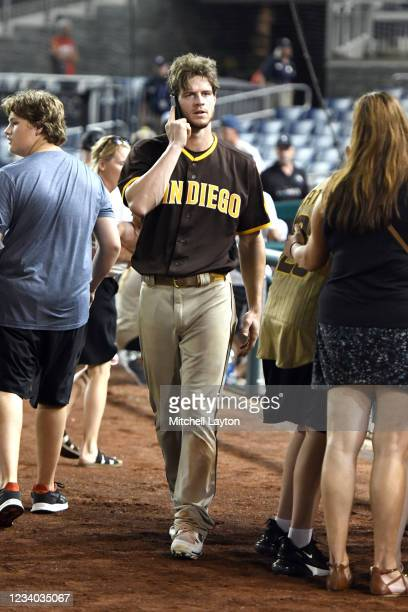 Wil Myers of the San Diego Padres looks for family after what was believed to be shots were heard during a baseball game between the San Diego Padres...