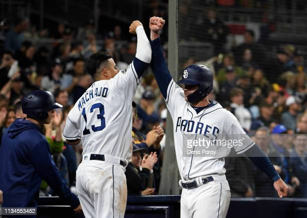 Wil Myers of the San Diego Padres right is congratulated by Manny Machado after hitting a tworun home run during the seventh inning of a baseball...