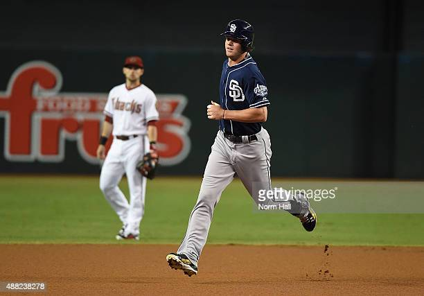 Wil Myers of the San Diego Padres rounds the bases after hitting a first inning home run against the Arizona Diamondbacks at Chase Field on September...