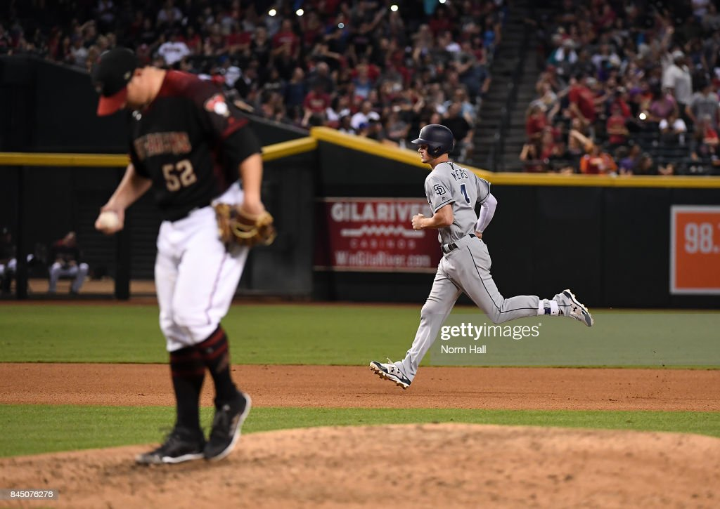 Wil Myers #4 of the San Diego Padres rounds the bases after hitting a two run home run off of Zack Godley #52 of the Arizona Diamondbacks during the seventh inning at Chase Field on September 9, 2017 in Phoenix, Arizona.