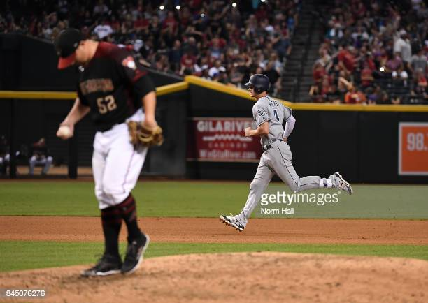 Wil Myers of the San Diego Padres rounds the bases after hitting a two run home run off of Zack Godley of the Arizona Diamondbacks during the seventh...