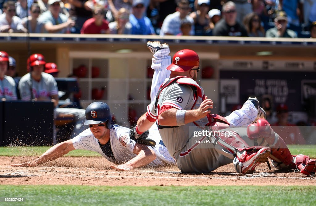 Wil Myers #4 of the San Diego Padres steals home ahead of the tag of Cameron Rupp #29 of the Philadelphia Phillies during the fourth inning of a baseball game at PETCO Park on August 16, 2017 in San Diego, California.