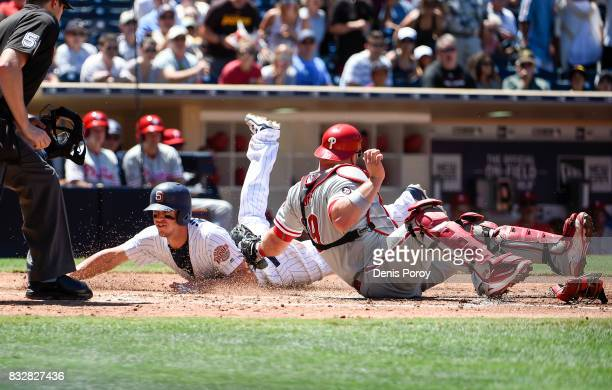 Wil Myers of the San Diego Padres steals home ahead of the tag of Cameron Rupp of the Philadelphia Phillies during the fourth inning of a baseball...
