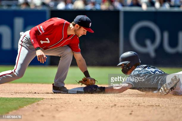 Wil Myers of the San Diego Padres steals second base ahead of the tag of Trea Turner of the Washington Nationals during the fifth inning of a...