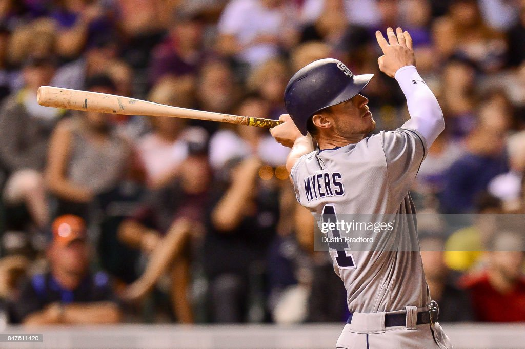Wil Myers #4 of the San Diego Padres watches the flight of a sixth inning solo homerun off of Tyler Chatwood #32 of the Colorado Rockies during a game at Coors Field on September 15, 2017 in Denver, Colorado.