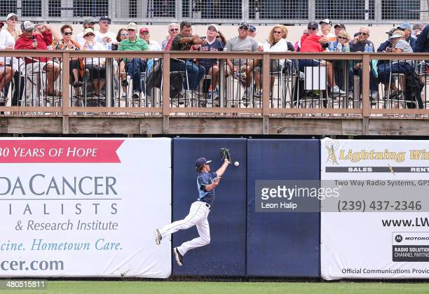 Wil Myers of the Tampa Bay Rays attempts to make the catch on the line drive from Mike Napoli of the Boston Red Sox during the fourth inning of the...