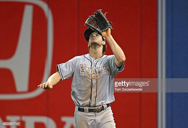 Wil Myers of the Tampa Bay Rays camps underneath the ball before catching a fly ball during MLB game action against the Toronto Blue Jays on May 26...