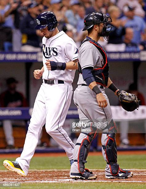 Wil Myers of the Tampa Bay Rays crosses home plate in front of catcher Yan Gomes of the Cleveland Indians to score off of a single by Yunel Escobar...
