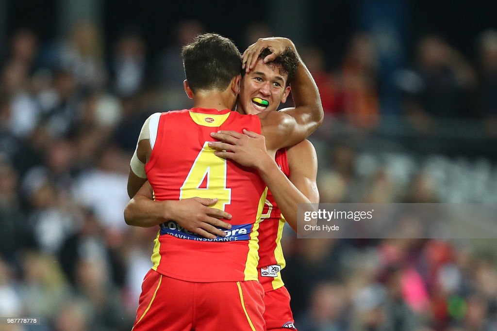 Wil Powell of the Suns celebrates his first goal during the round 15 AFL match between the Gold Coast Suns and the Collingwood Magpies at Metricon Stadium on June 30, 2018 in Gold Coast, Australia.
