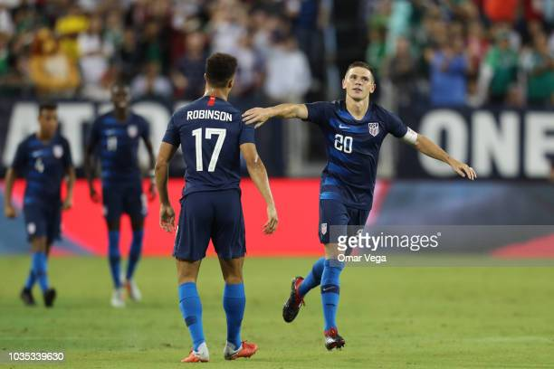 Wil Trapp and Antonee Robinson of United States celebrated scores during an international friendly match between Mexico and United States at Nissan...