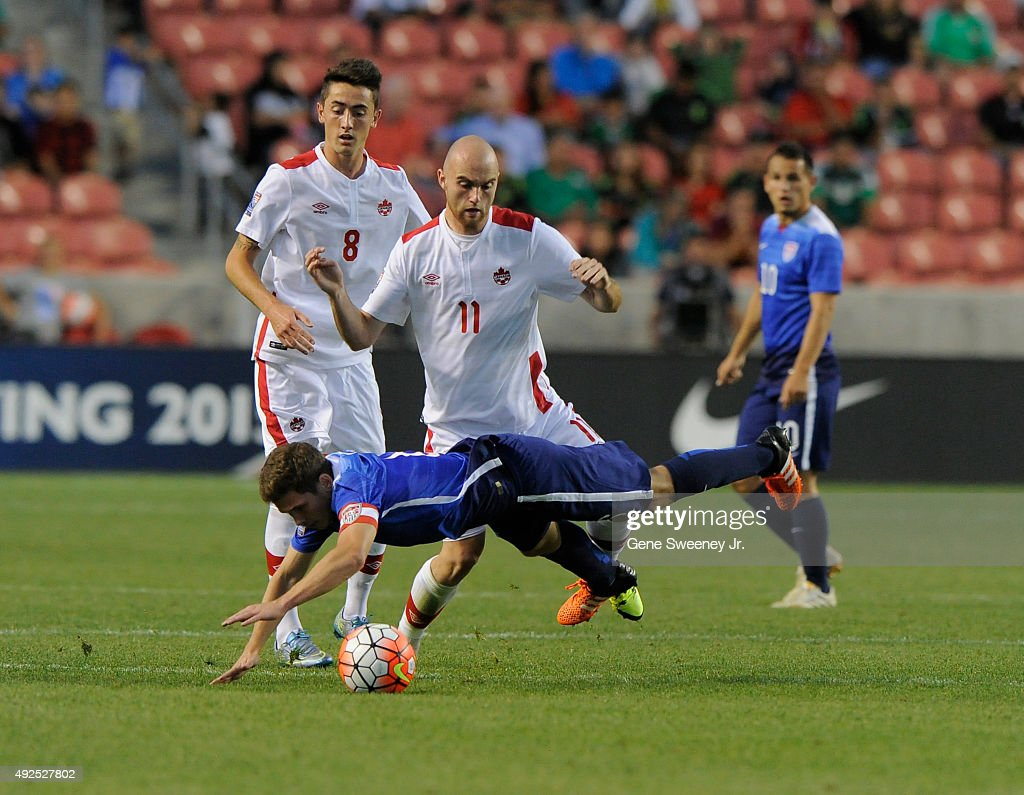 Wil Trapp #6 of United States is tackled by Jeremey Gagnon-Lapare #11 of Canada during the 2nd half of the third place CONCACAF Olympic Qualifying match at Rio Tinto Stadium on October 13, 2015 in Sandy, Utah. The United States beat Canada 2-0.