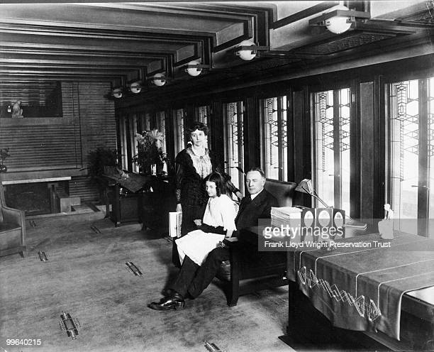Wilber family in Living Room looking southeast with original library table chairs and art glass Chicago Illinois 1916
