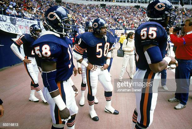 Wilber Marshall Mike Singletary and Otis Wilson of the Chicago Bears stand on the sideline before the game against the Dallas Cowboys at Texas...