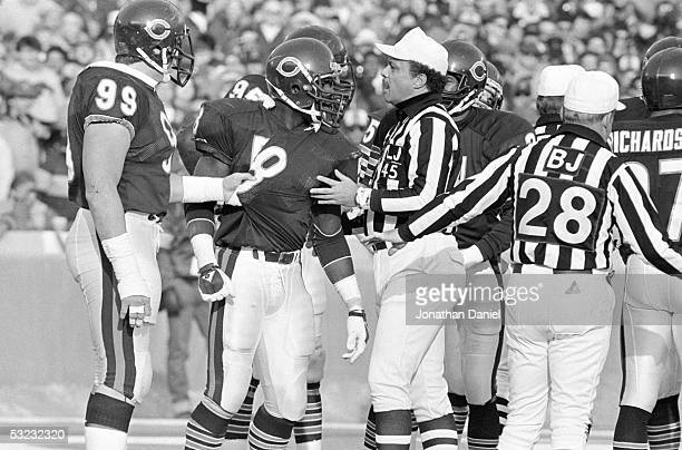 Wilber Marshall of the Chicago Bears argues with an official as teammate Dan Hampton attempts to restrain him during the game against the Dallas...